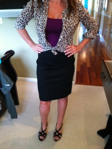 swapping the jacket for a leopard button-down, making it across town, and to her daughter's school function