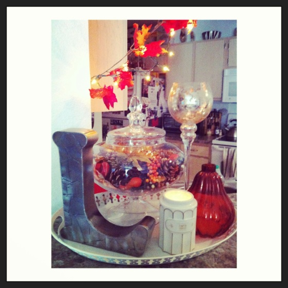 fall decor using a metallic initial, apothecary jar, mercury glass, and a boulangerie pumpkin souffle candle