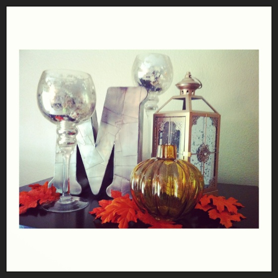 fall decor using metallic initial mercury glass, glass pumpkin & moroccan lamp