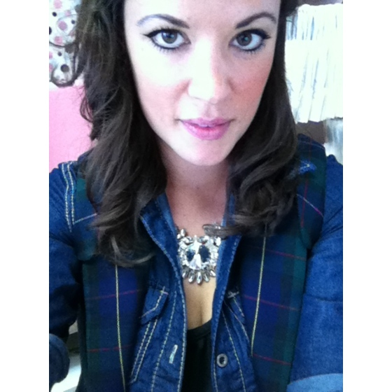 tartan vest over a denim shirt and crystal statement necklace