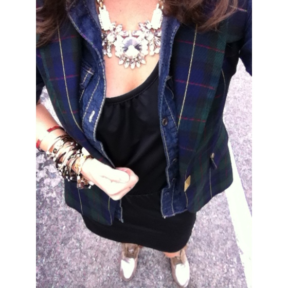 tartan vest over a denim skirt and black dress with silver boots