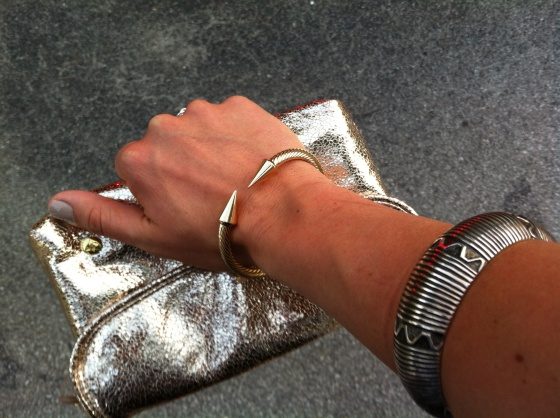 mixed metal bracelets and gold foil Stephanie Johnson clutch